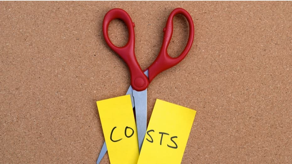 Scissors cutting a note that says 'costs'