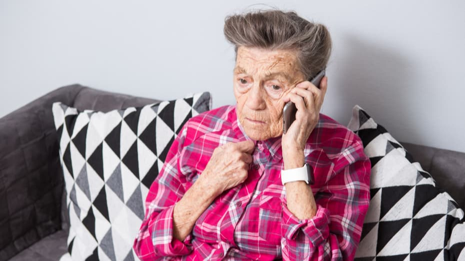 elderly woman getting scammed on the phone